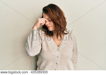 Young caucasian woman wearing casual clothes tired rubbing nose and eyes feeling fatigue and headache. stress and frustration concept.