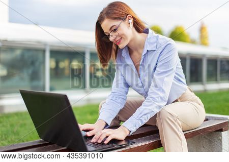 Young White Collar Caucasian Woman Using Laptop In Park, Wireless Communication