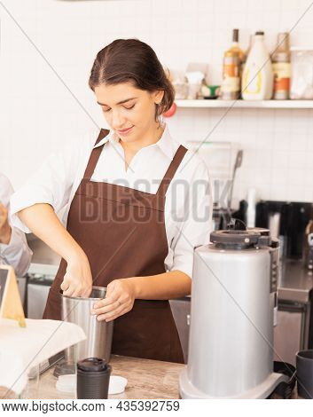 Beautiful Caucasian Barista Woman Scoops Coffee Beans From Coffee Equipment On Table In Cafe Coffee
