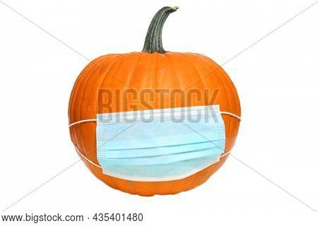 Coronavirus Pumpkin. Covid-19 Pumpkin. Be safe on Halloween and wear your mask. Coronavirus Halloween. Covid-19 Halloween Pumpkin. Halloween Jack O Lantern with a Medical Face Mask.