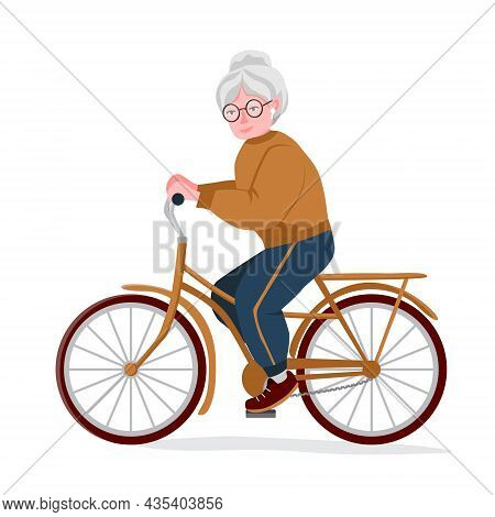 Athletic Grandmother Rides A Bike. An Old Woman Goes In For Sports. The Concept Of Longevity And A H
