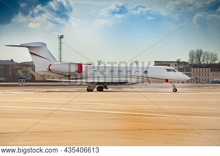 Small White Plane At The Airport. Runway. Charter Flight. Flight On A Journey. Fly In A Private Jet.