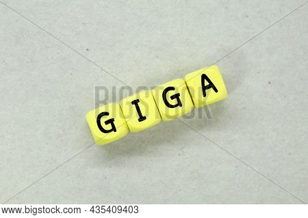 A Yellow Cube With The Word Giga. Technology Concept