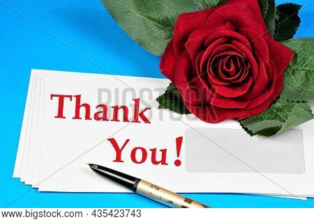 Thank You, The Inscription On The Envelope, A Polite Word, Expresses Gratitude. And A Red Rose Is A