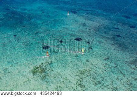 Windsurfers In Tropical Ocean At Paradise Mauritius. Aerial View.