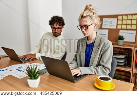 Business worker working and spying partner at the office.