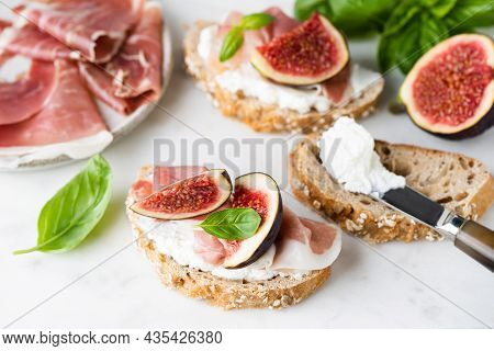 Toast Or Bruschetta With Ricotta Cheese, Prosciutto And Figs