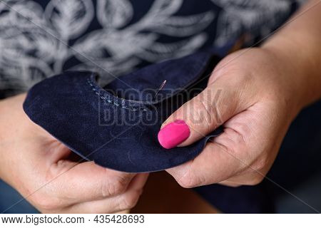 Woman's Hands Sewing Leather Blue Craft Shoes With Needle. Shoemaker Workshop Manufacturing Artisan