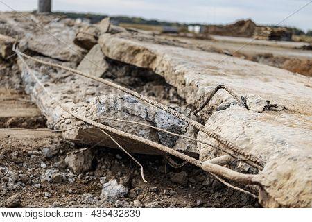 An Old Broken Reinforced Concrete Slab With Protruding Reinforcement. Dismantling Of Old Reinforced