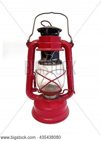 Old Bronze Boat Lamp On White Background. Close Up Of Red Bronze Kerosene Lantern. Isolated Retro Oi