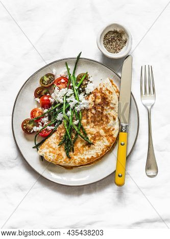 Oatmeal Crepes Without Flour With Asparagus, Feta, Cherry Tomatoes - Delicious Diet Breakfast On A D