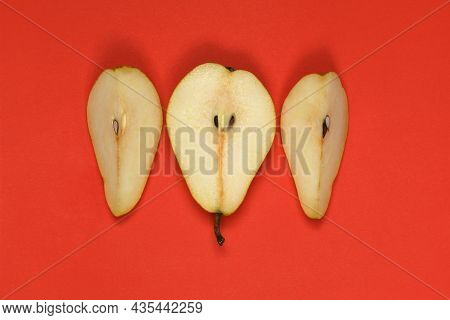 Pears Isolated On Red Background. Pears Macro Studio Photo. High Resolution Photo. Full Depth Of Fie