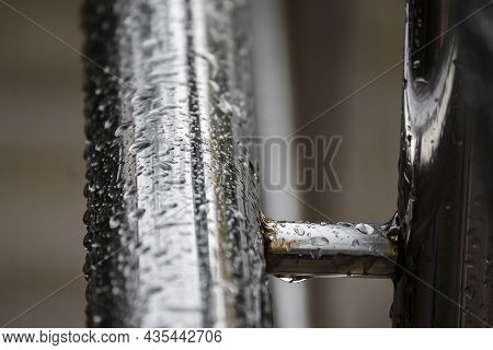 Wet Metal Chrome Railings Covered With Raindrops Begin To Rust At The Joint Or Welding Points. The I