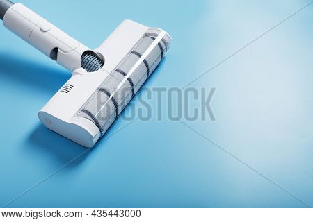 White Vacuum Cleaner Brush On A Blue Background, Top View. Cleaning Concept