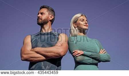 Confident Sport Couple. Muscular Man And Sexy Woman In Sportswear. Athlete People Feel Success. Fitn