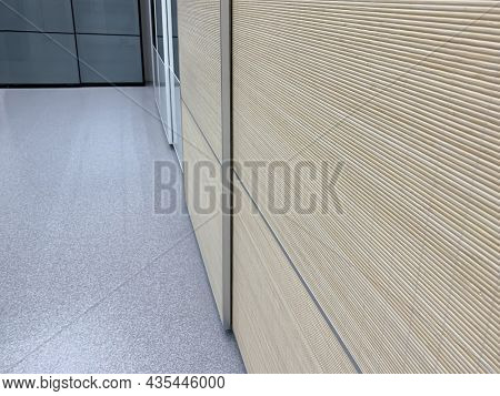 Sliding Doors Of Modern Wardrobe, Case Compartment With Brown Wooden Dood Panels In A Hallway Of A H