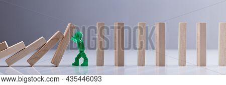 Falling Domino Risk Stop. Green Person Intervention