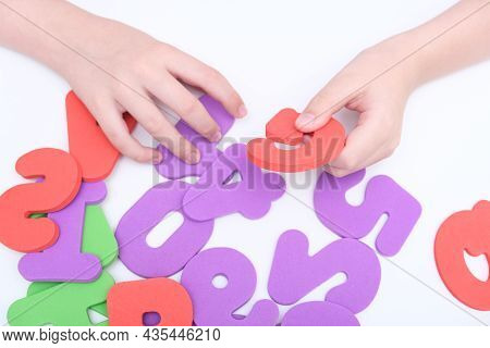 Hands Of A Child, Kid Holding Colorful Numbers During Education, Learning Math