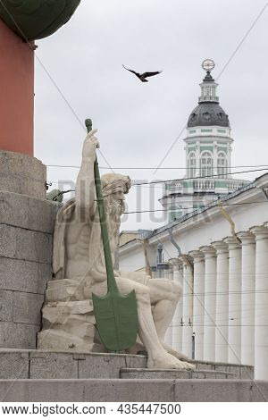 Sculpture At The Base Of The Rostral Column On The Spit Of Vasilievsky Island. Saint Petersburg, Rus