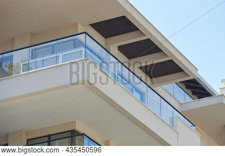 Balcony With Glass Railing In A Modern House