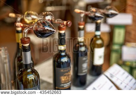 Montepulciano, Tuscany, Italy.august 2021. Close Up Shot Of Bottles With Cruet For Tasting In A Typi