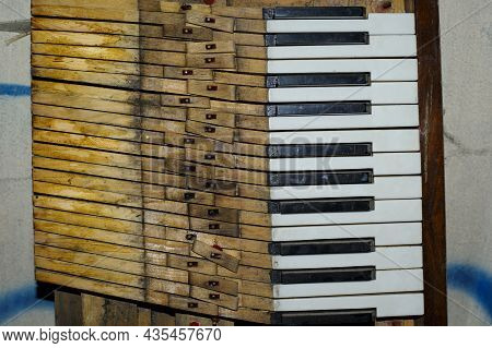 Keys. Black And White Keys Of An Old Piano. Details Of A Musical Instrument. Close-up. Disassembled,