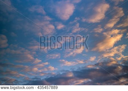 Blue Sky Background With Big Evening Striped Clouds. Blue Sky Panorama May Use For Sky Replacement
