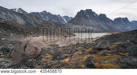 Dramatic Mountain Range In Remote Arctic Valley Of Akshayuk Pass, Baffin Island, Canada On A Cloudy