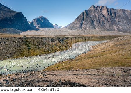 Wild Owl River Winds Through Remote Arctic Landscape In Akshayuk Pass, Baffin Island, Canada. Moss V