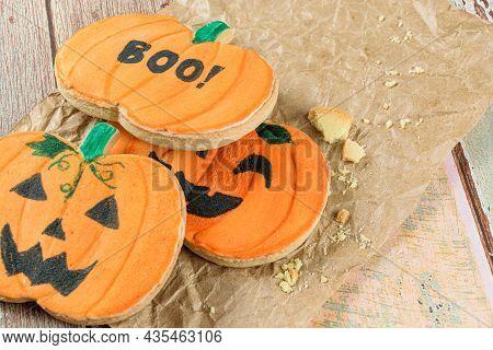 Pumpkin-shaped Buttery Cookies Closeup On Brown Paper.
