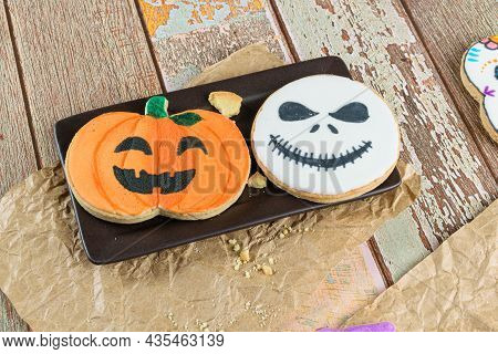 Halloween Themed Buttery Cookies On A Brown Plate.