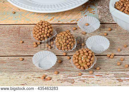 Three Brigadeiros (brigadiers) Of Dulce De Leche With Small Crunchy Balls Of Salted Caramel.