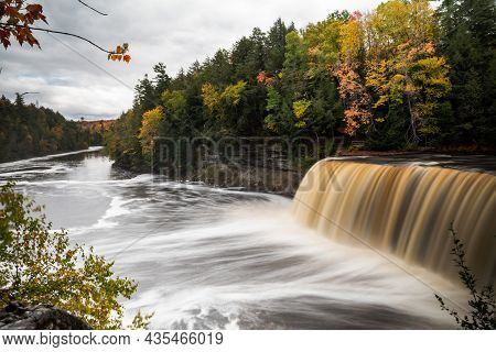 Beautiful Panoramic Autumn Photograph Of Upper Tahquamenon Falls In Michigan With Water Cascading In