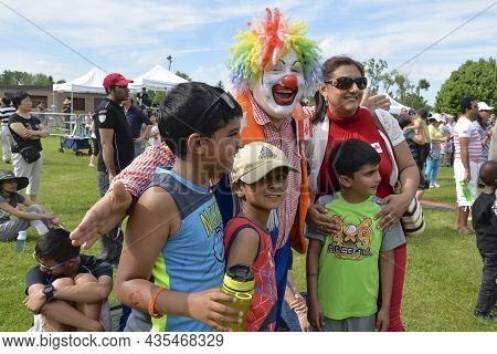 Unionville, Ontario / Canada - July 01, 2014: Clowns Welcome Multi-ethnic Group In The Canada Day Pa