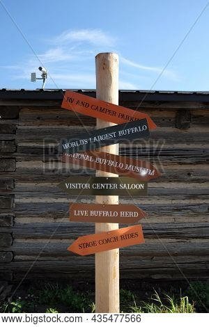 JAMESTOWN, NORTH DAKOTA - 3 OCT 2021: Frontier Town sign post with directions to the various attractions.