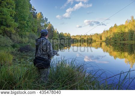 Kostroma Region, Russia - September 19, 2018: A Fisherman With A Spinning Rod On The Shore Of A Fore