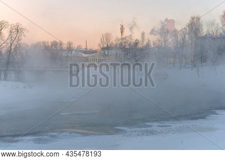 Winter Fog On The River On A Frosty February Morning. Vytegra, Russia