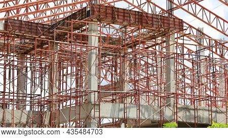 Scaffolding Metal Prop. Red Iron Is A Props To Support Formwork Slabs On A Construction Site. Select