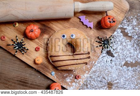 Cooking Delicious Homemade Cake And Decorate Donut For Halloween Festive. Sweet Dessert And Decorati
