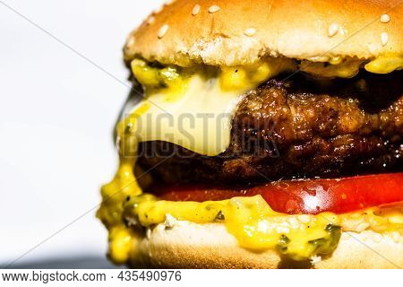 Detail Of Tasty Beef Cheeseburger Isolated On White Background. Cheeseburger With Pickles, Tomatoes,