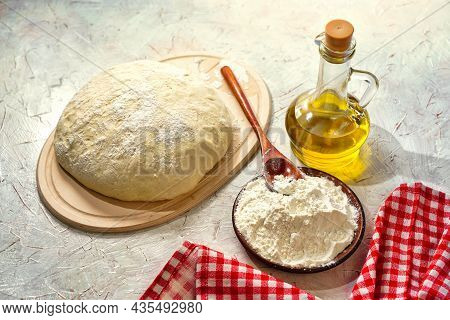 Preparation Pizza Dough, Olive Oil. Yeast Dough Made From White Wheat Flour. Homemade Bread