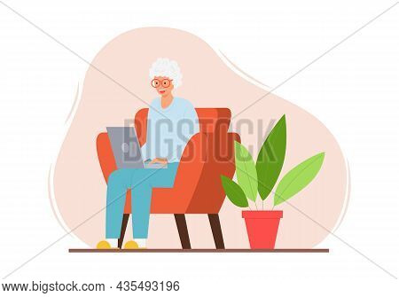 A Happy Elderly Woman Is Sitting In A Chair In A Home Interior With A Laptop. A Smiling Adult Modern