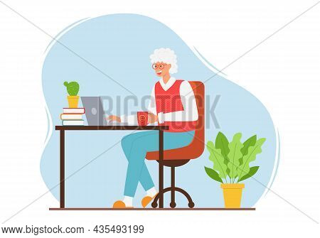 A Happy Elderly Woman In A Vest And Trousers Is Sitting At A Table With A Laptop. An Adult Modern Gr