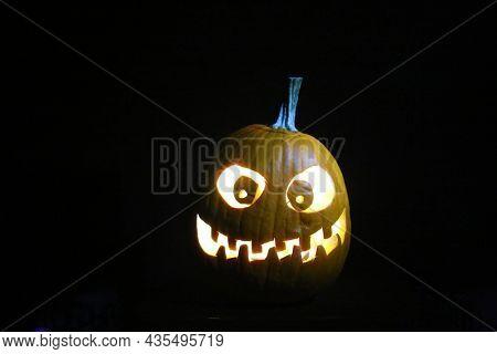 Halloween Pumpkin. Halloween pumpkin in party mood.  Jack O Lantern.  Halloween Jack O Lantern in the dark.