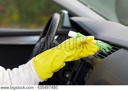 A Hand In Yellow Rubber Gloves Wipes The Dashboard Of A Car From Dust With A Special Brush On A Brig