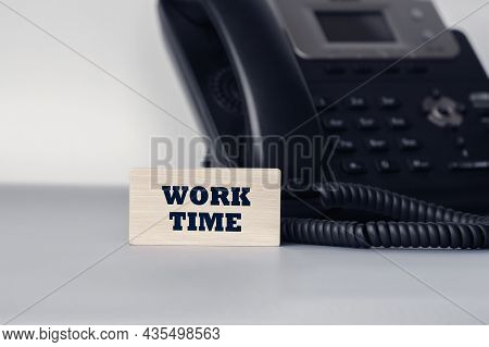 Closeup Of The Wooden Block With Text - Work Time. Office And Communication Concept