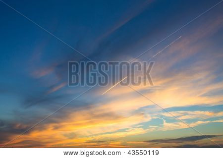 Bright And Dark Sides Of Sunset Sky Background