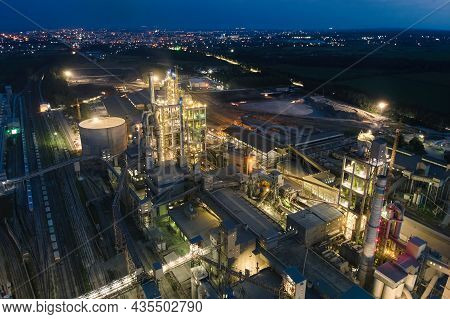 Aerial View Of Cement Factory With High Concrete Plant Structure And Tower Cranes At Industrial Prod