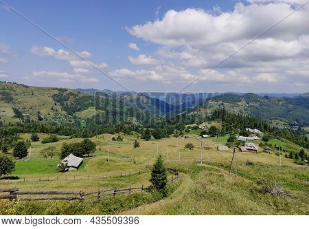 Village In The Mountains In Summer. Panorama Of The Mountain On A Sunny Day. Sunny Summer