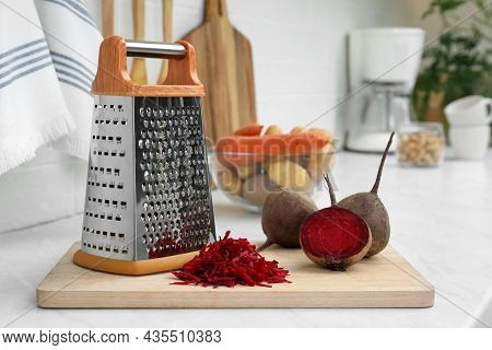 Grater And Fresh Ripe Beetroots On Kitchen Counter